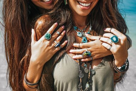 Foto de close up of two cheerful stylish women twin sisters having fun outdoors - Imagen libre de derechos