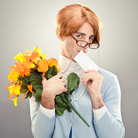 ugly woman with glasses hold flowers on grey background