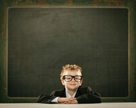 Photo pour young clever scientist children students write on  blackboard - image libre de droit
