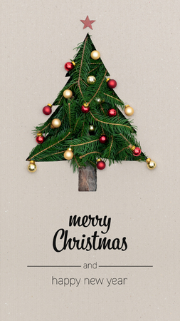 Foto de Merry Christmas and happy new year greetings in vertical top view cardboard with natural eco decorated christmas tree pine.Xmas winter holiday season portrait social media card background - Imagen libre de derechos