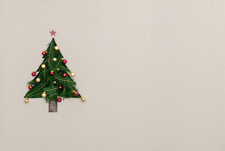 Foto de Text or empty copy space in vertical top view cardboard with natural eco decorated christmas tree pine.Xmas winter holiday season party social media card background - Imagen libre de derechos