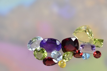 Photo for Lots of colorful gems on a pastel background - Royalty Free Image