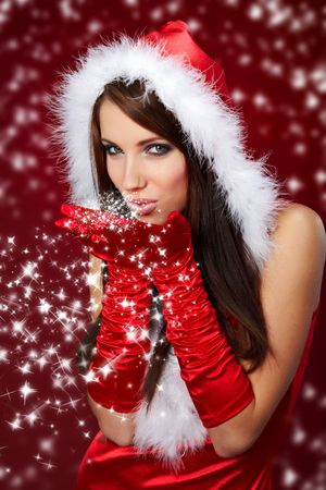 Portrait of beautiful sexy girl wearing santa claus clothes on red backgroundの写真素材