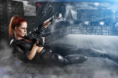 Photo for beautiful sexy girl holding gun . smoke background  - Royalty Free Image
