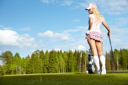 Young blonde  woman with golf equipment