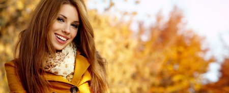 Beautiful elegant womanin autumn parkの写真素材