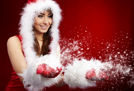 Photo of fashion Christmas girl blowing snow. の写真素材