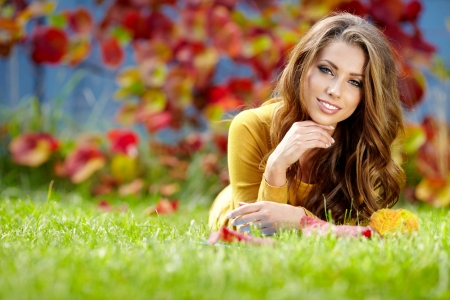 beautiful girl with book in the autumn park の写真素材