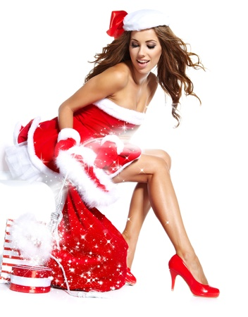 beautiful sexy girl wearing santa claus clothes with christmas gift の写真素材