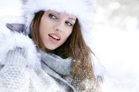 Snow winter woman portrait outdoors on snowy white winter day