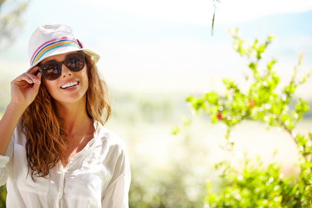 Photo for Smiling summer woman with hat and sunglasses - Royalty Free Image