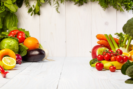 Fruit and vegetable borders Fruit and vegetable borders on wood tableの写真素材