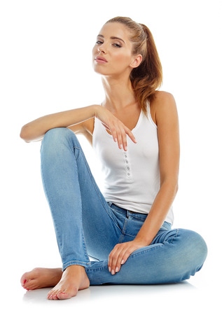 Foto de Young girl in jeans and a white t-shirt - Imagen libre de derechos