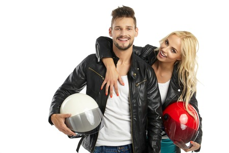 Photo for motorcyclists couple with helmets in hand. Studio shoot - Royalty Free Image