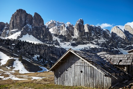 An Alpine meadow with  old wooden farmhouse, Dolomites, Italian Alps