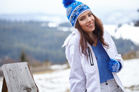 woman in a winter sweater and cap