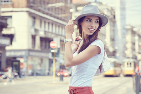 Photo for Fashionably dressed woman on the streets of a small Italian town, shopping concept - Royalty Free Image
