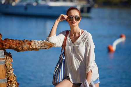 Photo pour woman with sunglasses of marina on hot summer day - image libre de droit