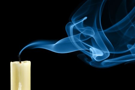 Extinguished candle with smoke close-up