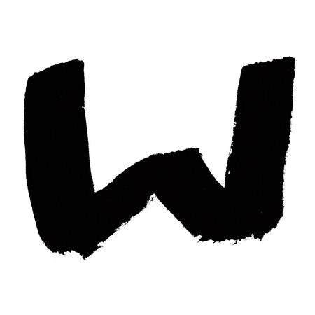 W - Black ink letters isolated over the white background