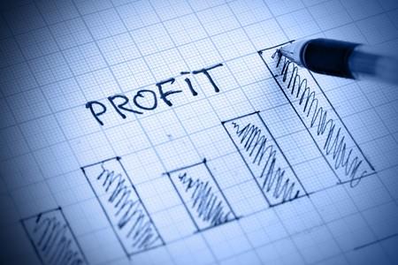 Pen drawing profit bar chart. Shallow DOF!