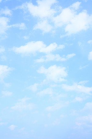Light blue spring sky with clouds, may be used as background