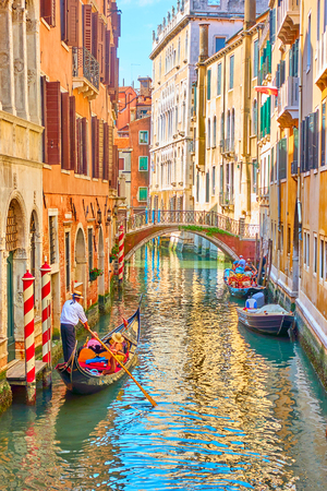 Foto per Venetian canal with gondola on sunny summer day, Venice, Italy - Immagine Royalty Free
