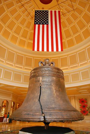 American heritage bell and flag, proudly displayed
