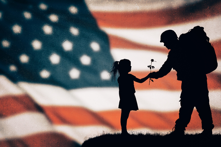 Foto per American soldier silhouette on the american flag - Immagine Royalty Free