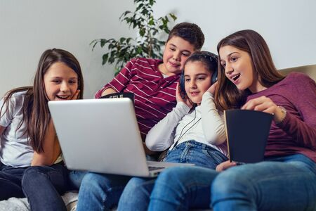 Photo pour Laughing friends watching funny video on laptop - image libre de droit