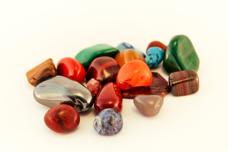 Semi precious stones / Crystal Stone Types / healing stones, worry stones, palm stones, ponder stones / Various stones gemstones background texture / Heap of various colored gems mineral collection.