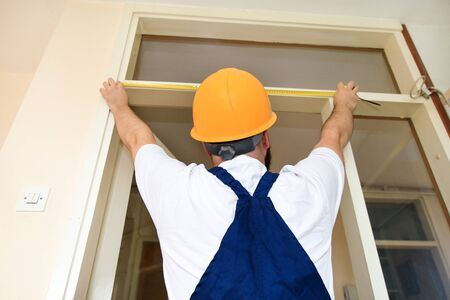 Construction worker and handyman is working on renovation of apartment.