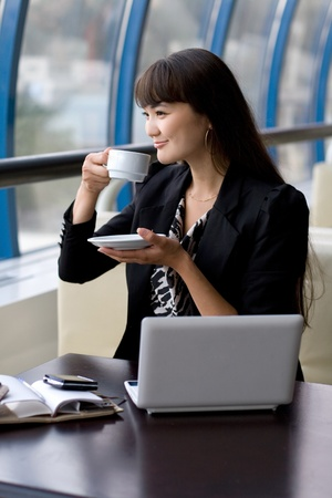 Photo for Businesswoman having a cup of tea - Royalty Free Image