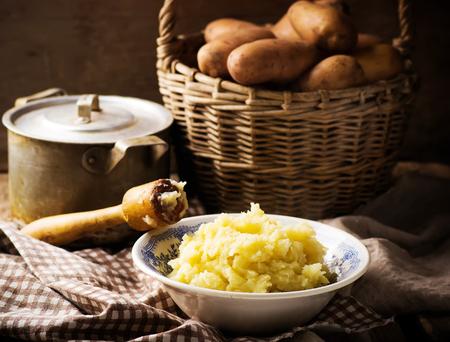 Foto für Mashed potatoes  and raw potato in the basket. style rustic.selective focus - Lizenzfreies Bild