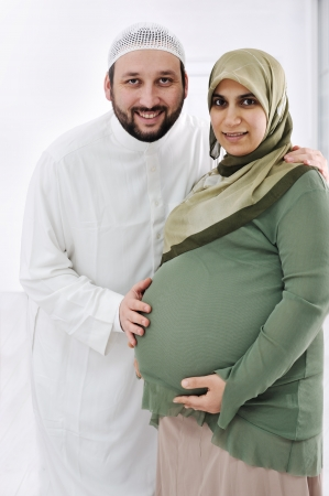 Portrait of a happy young pregnant muslim woman with her husbandの写真素材