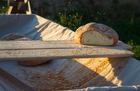 Sliced bread in the cart in the evening outdoors. Bread crumbs around