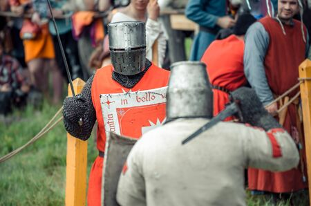 Photo for RITTER WEG, MOROZOVO, APRIL 2017: Festival of the European Middle Ages. Medieval joust knights in helmets and chain mail battle on swords with shields in their hands - Royalty Free Image