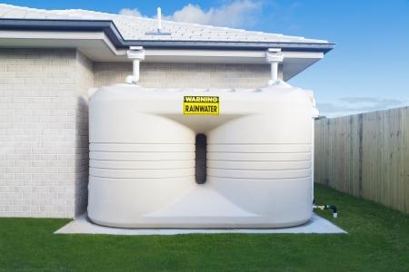 Large rain water tank in suburban backyard