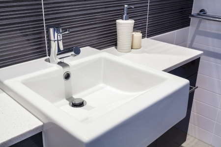 Close up of sink in new bathroom