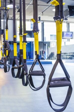 Suspention training straps in fitness studio