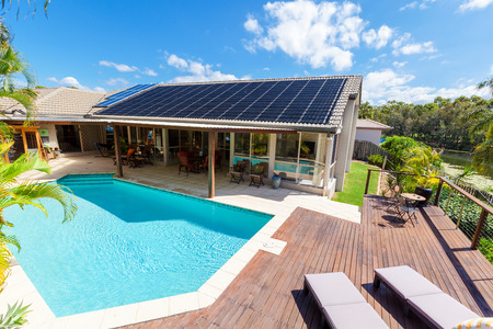 Photo for Backyard with swimming pool in stylish home - Royalty Free Image