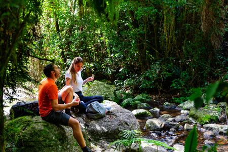 Photo for Couple enjoying lunch in lush Australian rainforest, QLD - Royalty Free Image