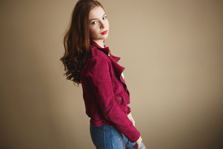 Photo pour Young hipster woman clothed in magenta jacket. Beautiful eyes, long brown curly hair - image libre de droit