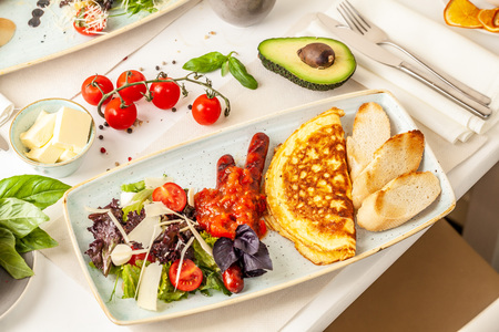 Photo for The concept of an Italian breakfast. omelette and salad. background image. Copy space, selective focus - Royalty Free Image