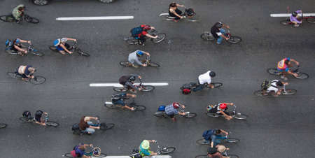 Bikers travelling through the city to make an environmental friendly statement, shot from above.