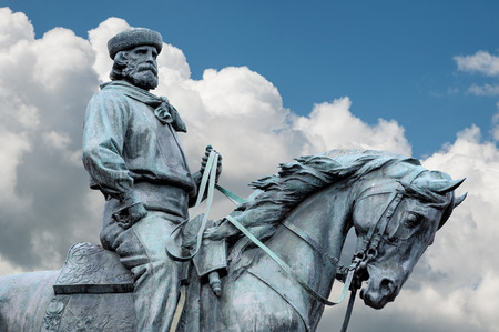 Giuseppe Garibaldi, the Hero of Two Worlds, equestrian statue with blue sky and clouds on background