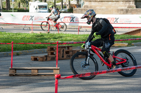 Florence, Italy - April 13, 2018: Electric mountain bike on the test track, during a free show at the ? ? ? Parco delle Cascine?? public park, in Florence.