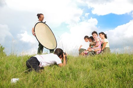 Professional photographer is shooting in nature with assistent