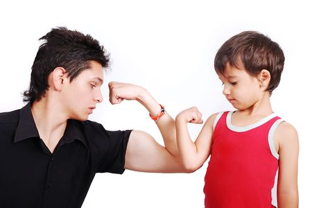 Young male model is showing muscles to little boy