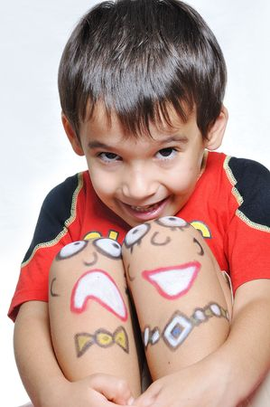 Cute kid with painting on legs